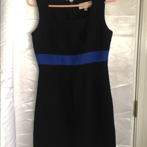 Black sleeveless dress. All occasion style.